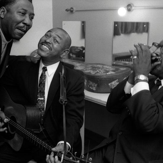 Backstage at the 1964 Blues and Gospel Caravan, L-R: Otis Spann, Muddy Waters, Brownie McGee, Sonny Terry