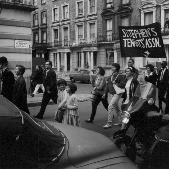The St Stephen's Tenants' Association carry banners down St Stephen's Gardens during a civil rights march in Notting Hill, circa 1963