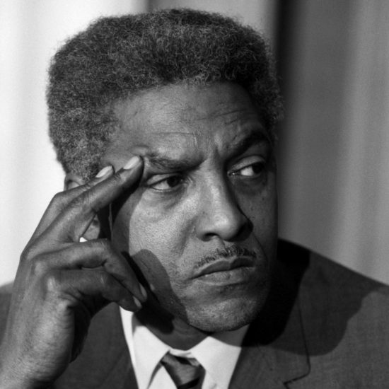 A close-up of American civil rights campaigner Bayard Rustin during a press conference given by Dr Martin Luther King Jr. at the London Hilton Hotel,  on 06 December 1964