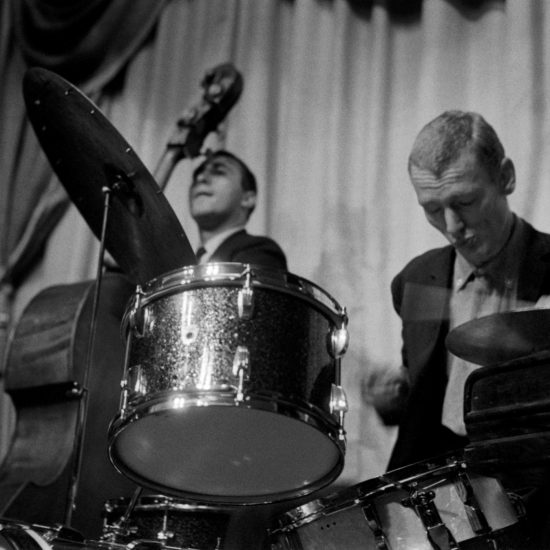 Graham Bond Organisation play on stage. L-R: Jack Bruce on double bass, Ginger Baker on drums, circa 1963