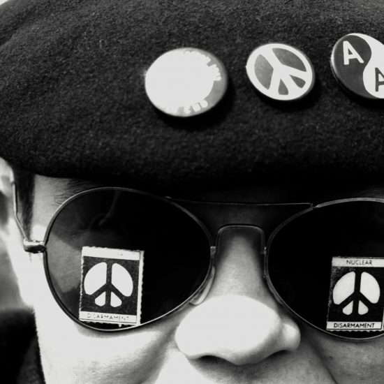 A marcher wears sunglasses with Nuclear Disarmament and the CND sign stickers on the lenses during the Aldermaston-London CND march, England circa April 1962