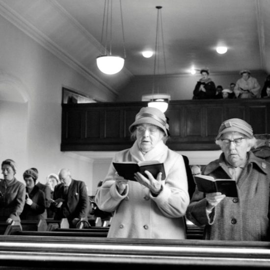 Members of the congregation sing hymns in their parish church situated in Kinglassie mining village, Fife, Scotland, circa 1963