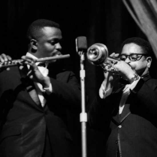 American jazz musicians Eric Dolphy on flute and Dizzy Gillespie on trumpet play together on stage, circa 1961