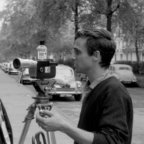 Filmmaker Gavrik Losey directs one of the actors during the making of the movie 'Spade Fade' on Westbourne Terrace, West London, circa 1962