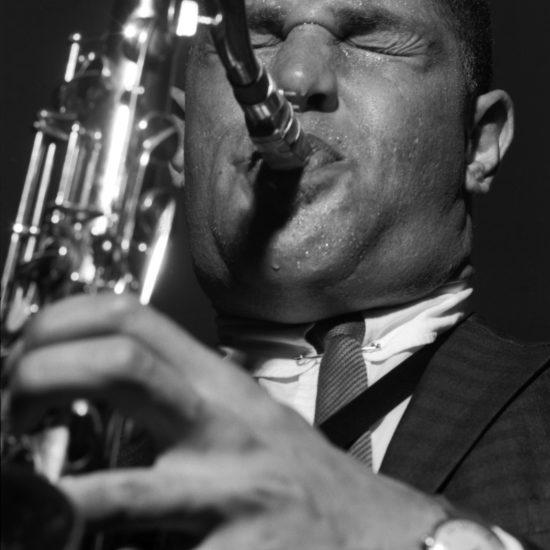 Dexter Gordon on tenor saxophone at Ronnie Scott's, Wardour Street, London, in close up, circa 1962