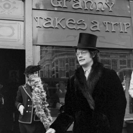 Shop owner and founder Nigel Waymouth poses with a female friend outside Granny Takes A Trip, 1966. They are both dressed in fashionable Edwardian-style clothes from the boutique located at 488 King's Road, Chelsea, London