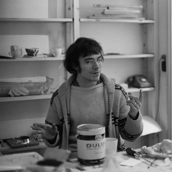 British artist John Dunbar smokes and gesticulates whilst surrounded by painting and decorating materials during internal construction of Indica Books and Gallery in Mason's Yard, London, late 1965