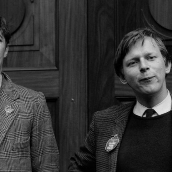 A close up image of Richard Ingrams and John Wells during the 01 May 1965 'Mass for Vass