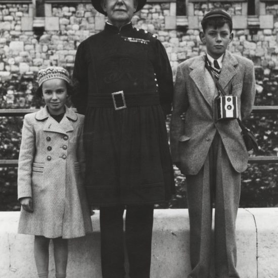 Hoppy and Marilyn Hopkins with a Yeoman Warder at the Tower of London, circa 1946-7
