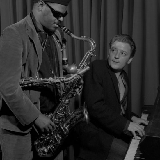 American jazz multi-instrumentalist Rahsaan Roland Kirk on saxophone and British jazz pianist Stan Tracey during a rehearsal at Ronnie Scott's, circa 1963