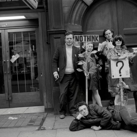 Prior to attending the last day of the Aldermaston-London CND rally in Trafalgar Square, Easter Monday, 1966. L-R: Jeff Nuttall, John 'Hoppy' Hopkins (lying down), Kate Heliczer, Harry Fainlight, Michelle Poole, Greg the Thief