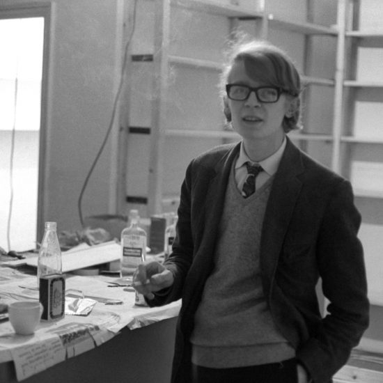 British author, bookseller and founder of Indica Books and Gallery Barry Miles, photographed surrounded by painting and decorating materials in Mason's Yard, London, late 1965