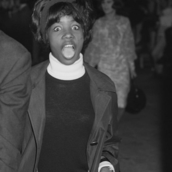 Millie Small, the Jamaican singer-songwriter who sang 'My Boy Lollipop', pulls a 'shocked' face before performing onstage at The All Night Rave at Alexandra Palace, 26 June 1964