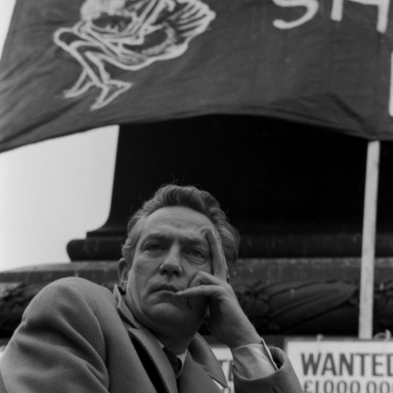 Actor Peter Finch onstage at a campaign launch for famine relief in Trafalgar Square celebrating 21 years of Oxfam, 06 October 1963