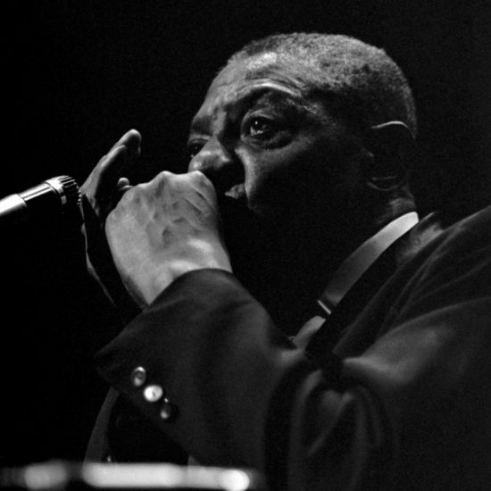 American blues harmonica player, singer and songwriter Sonny Boy Williamson plays harmonica on stage in London in close up, October 1963