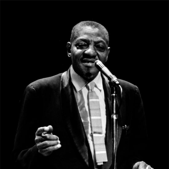 American blues harmonica player, singer and songwriter Sonny Boy Williamson sings and holds a harmonica on stage in London in close up, October 1963