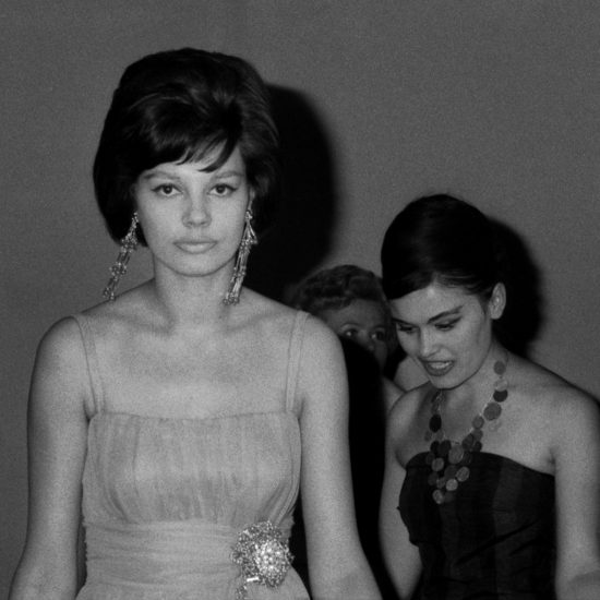 Three models in evening wear queue backstage during a fashion show at the USSR Industrial Exhibition in London, held at Earl's Court, 07-29 July, 1961